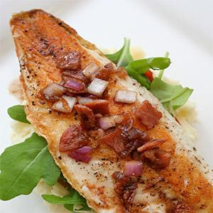 image for a Couples Cook A Sophisticated Coastal Menu... featuring Sea Bass