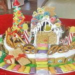 The image for Santa's Workshop: A Family-Friendly Gingerbread House-Making Party (for kids 5+ and adults)